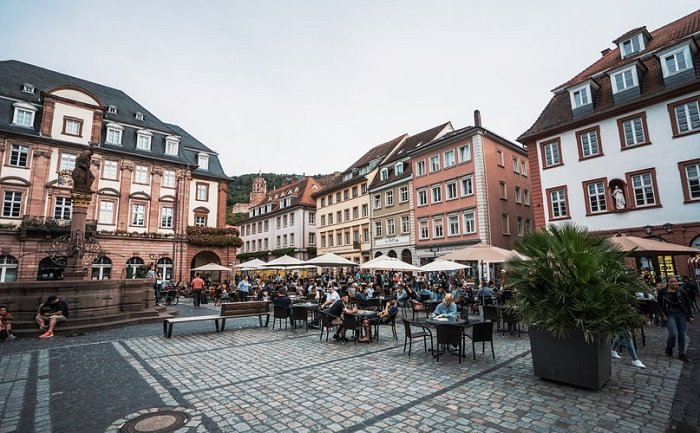 image of customers seated outdoors in a town square