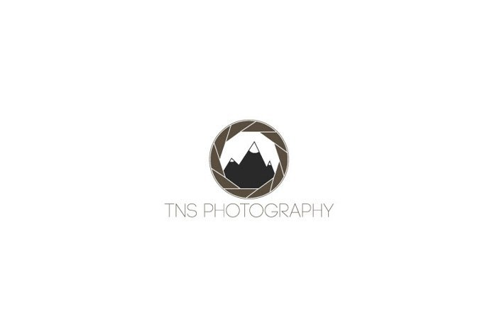 TNS Photography logo using an image of a lens aperture