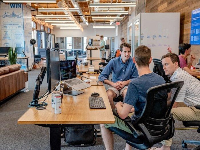 men having a meeting in an open office space