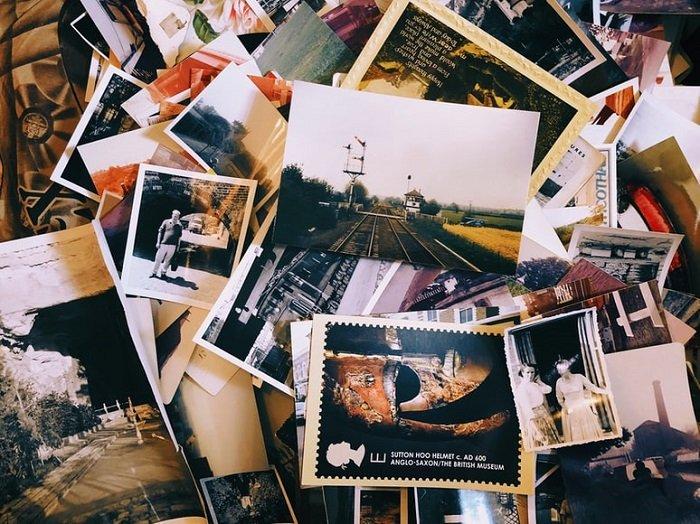 pile of printed photographs for portfolio