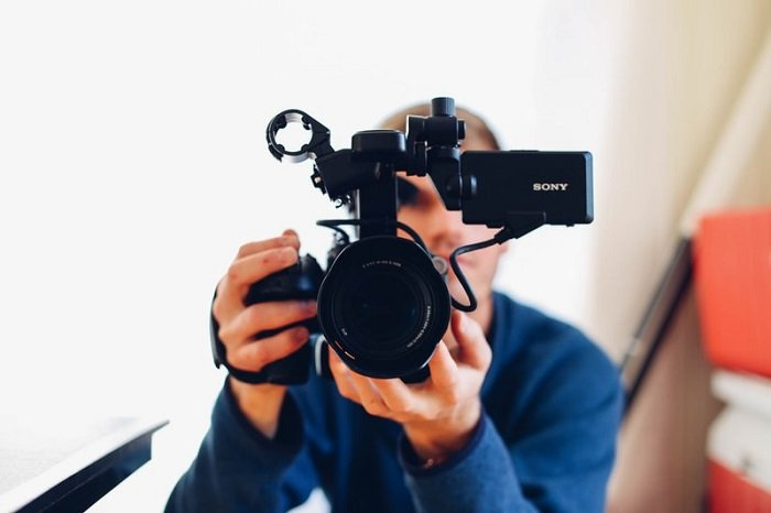photographer holding a camera