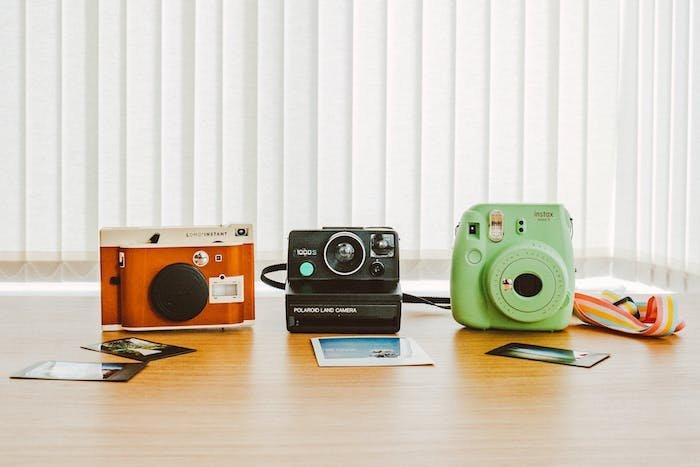 instant print cameras on a desk