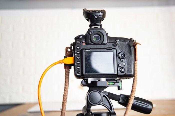 A closeup of a tethered camera