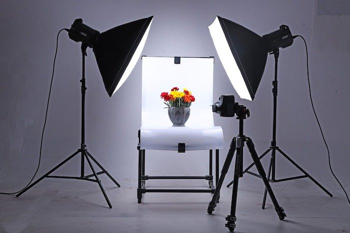 image of a vase of flowers being shot in a studio with a white background and large lights