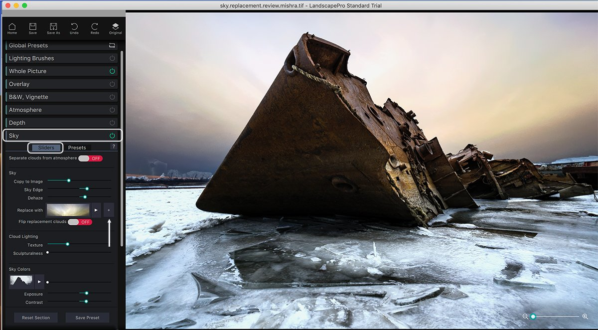 Rusted shipwreck on icy water with sky replaced using Landscape Pro