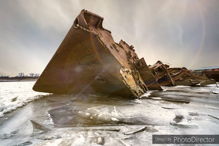 Rusted shipwreck on icy water with AI sky replacement using PhotoDirector 365