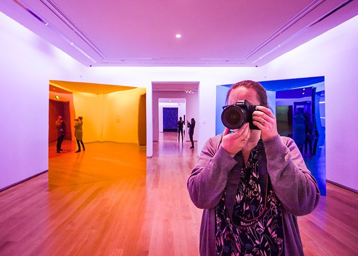 colorful photography: a photographer taking a photo in a room full of warm and cool colors
