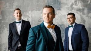 groomsmen photo idea: Three guys in suits