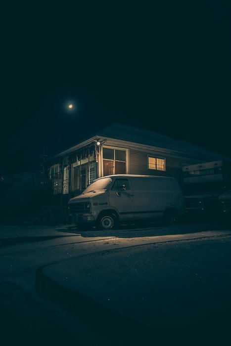 low light photography idea: a sole lamp illuminates a van
