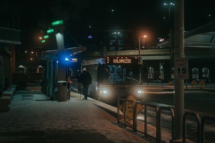 multiple lights illuminate a bus stop in kalamazoo